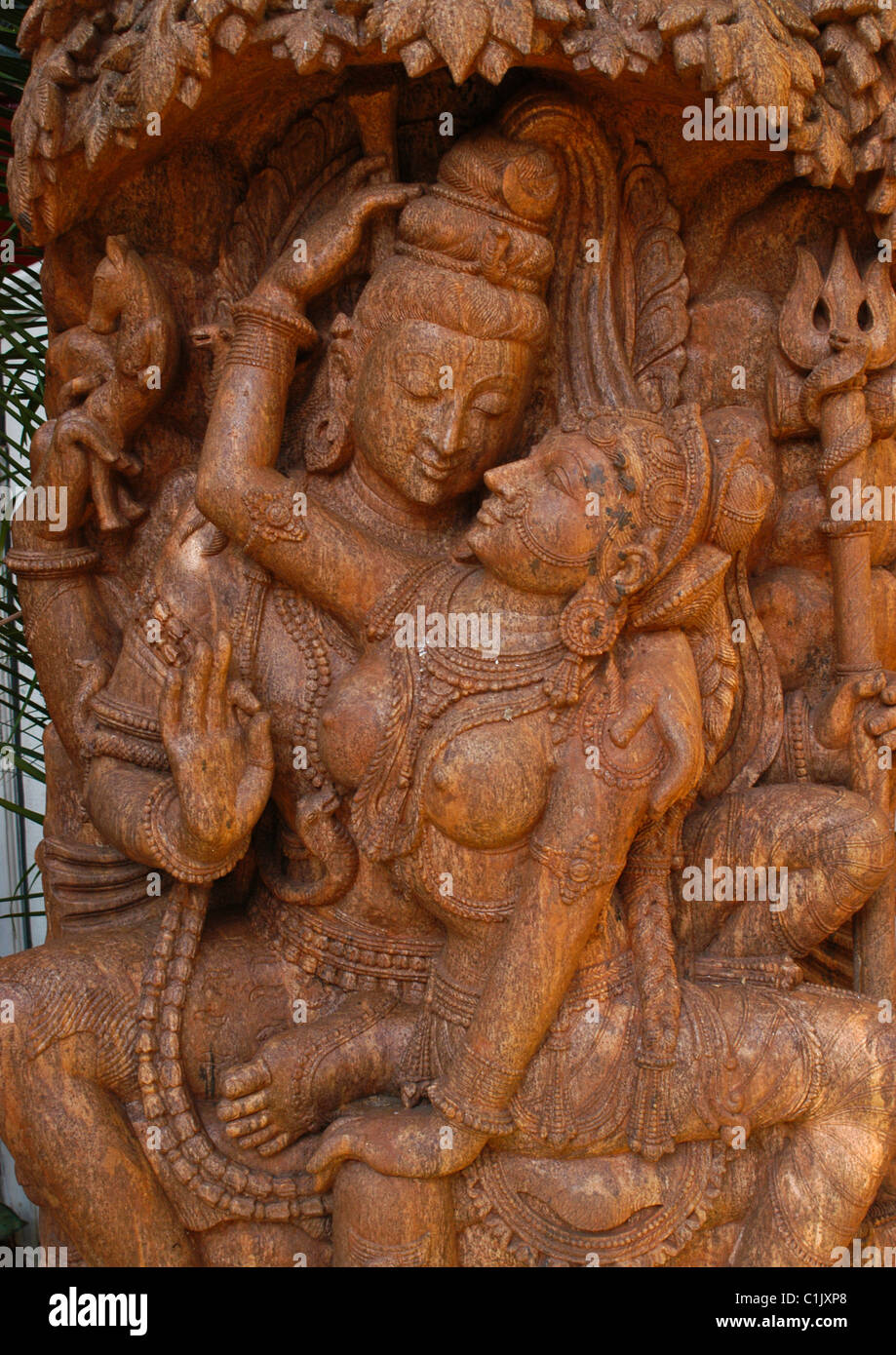 Hand carved statue in red marble of lord shiva and goddess parvati hand carved statue in red marble of lord shiva and goddess parvati depicting enchanting spiritual symbol of truth and energy biocorpaavc