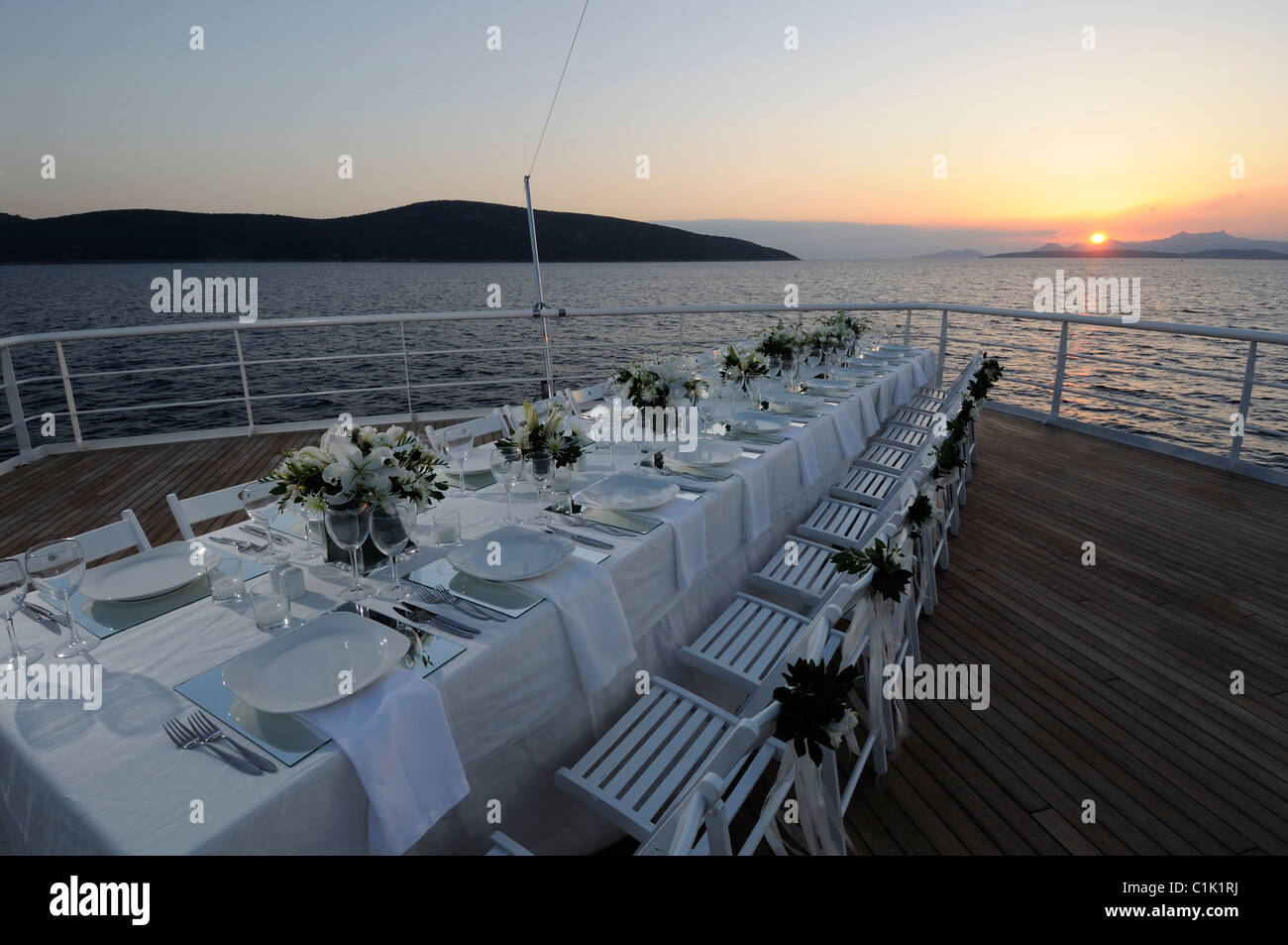 wedding party table on the deck of luxury cruise ship