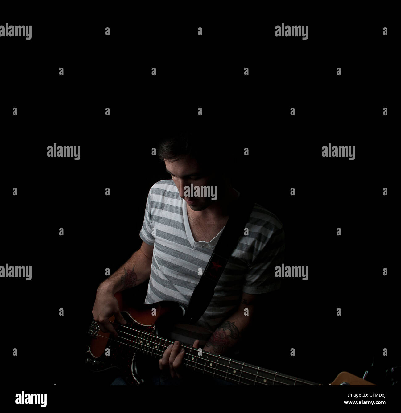 Fingerless gloves for guitarists - Man Playing Bass Guitar Stock Image