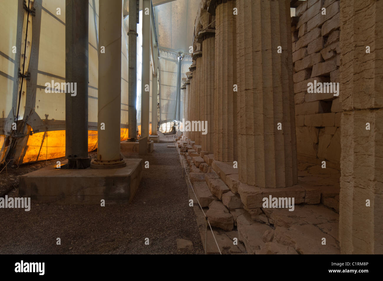 Inside the re-construction tent covering the Temple of Apollo in the southern part of Greece & Inside the re-construction tent covering the Temple of Apollo in ...