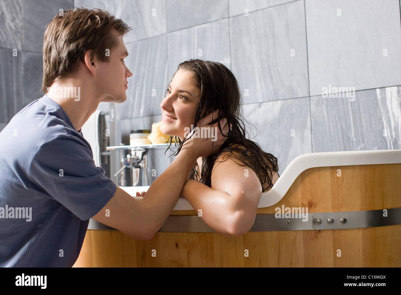 man kissing woman in bathroom