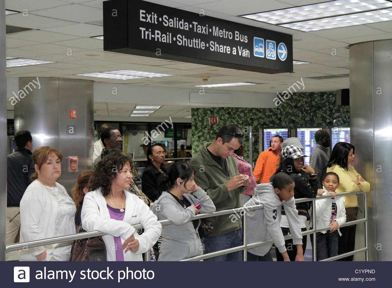 customs airport w stock photos customs airport w stock miami florida miami international airport mia terminal customs arrivals hispanic black man w boy girl families