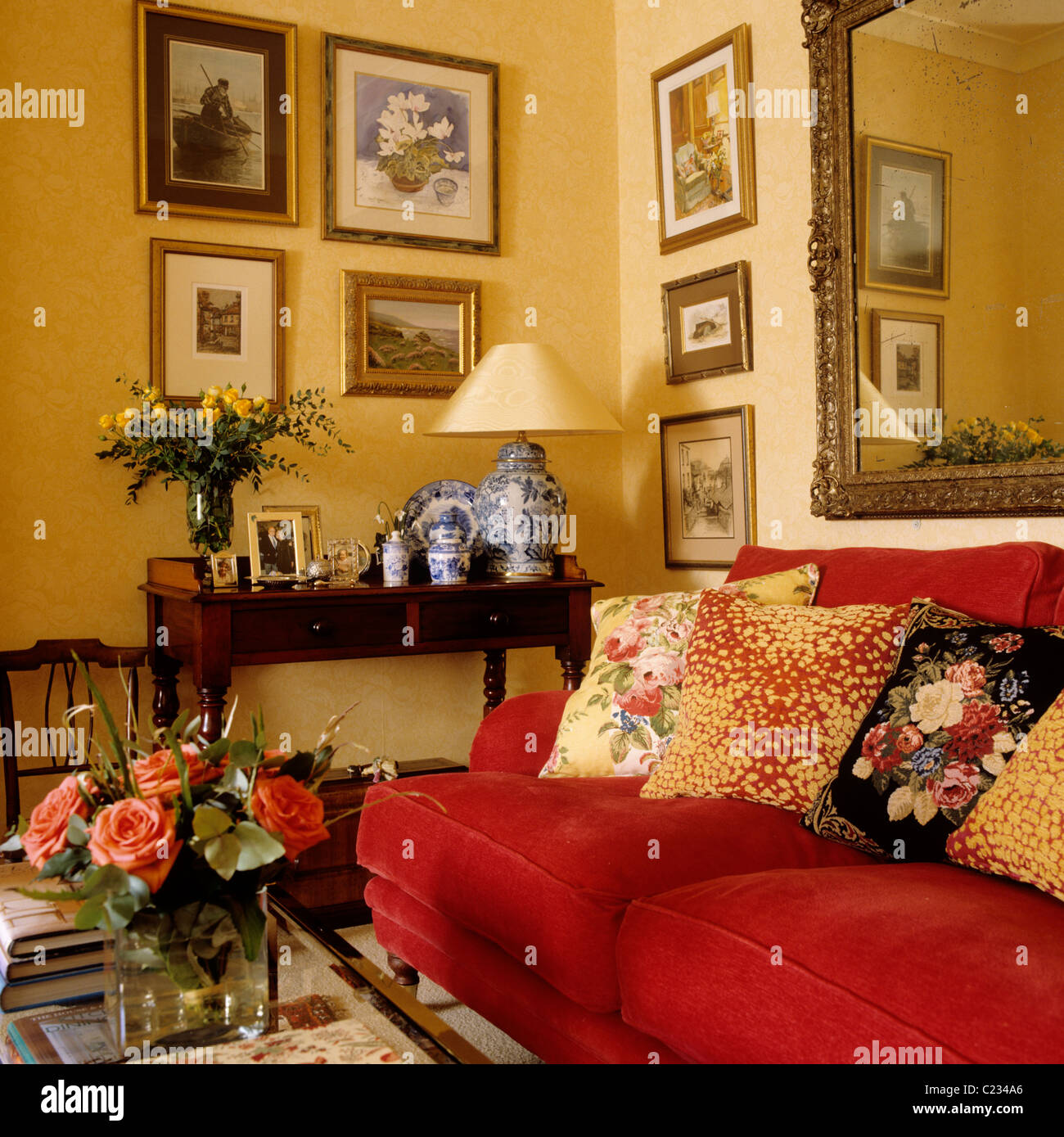 Patterned Cushions On Red Sofa In Living Room With A Traditional English Country Interior