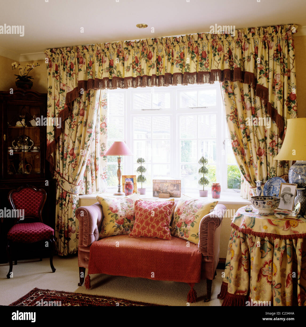 Small Sofa In Front Of Window With Floral Patterned Curtains And Stock Photo Royalty Free Image