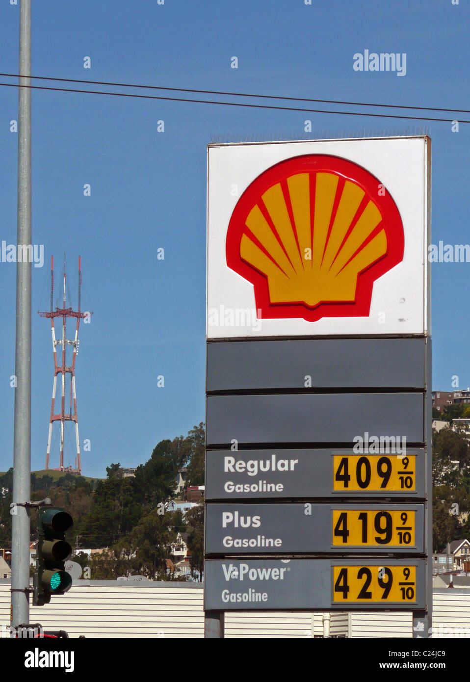 shell gas station sign showing gasoline prices over 4 per