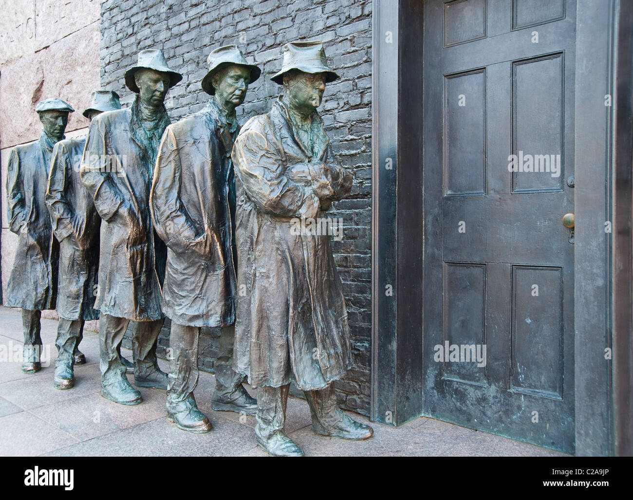 Bronze Statues Of Common Depression Era Men Standing In A Soup Kitchen  Line. This Statuary Is Located At The FDR Memorial In DC.