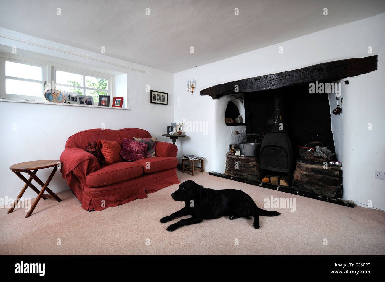 traditional cottage living room with an inglenook fireplace uk