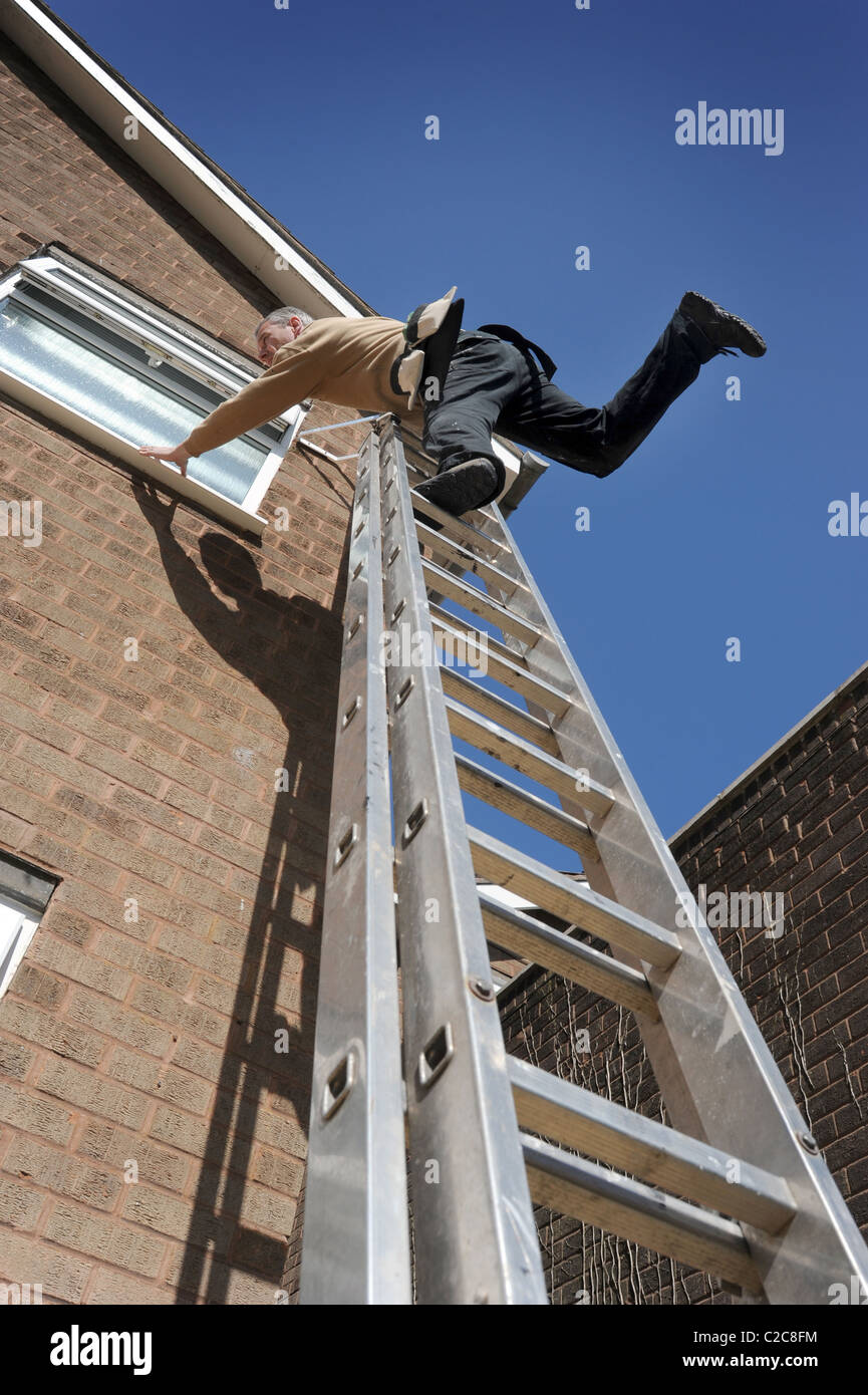 Workman Over Balancing On Ladders Working On House Re