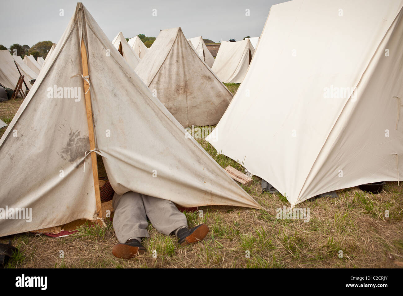Confederate re-enactor feet stick of tent asleep Charleston SC marking the 150th anniversary of the US Civil War & Confederate re-enactor feet stick of tent asleep Charleston SC ...