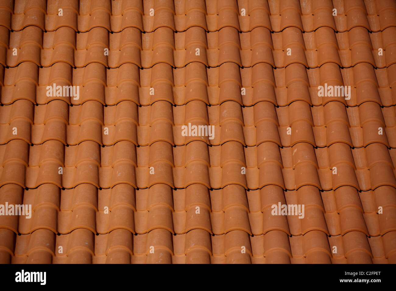 A newly constructed roof with terracotta roof tiles stock photo a newly constructed roof with terracotta roof tiles dailygadgetfo Image collections