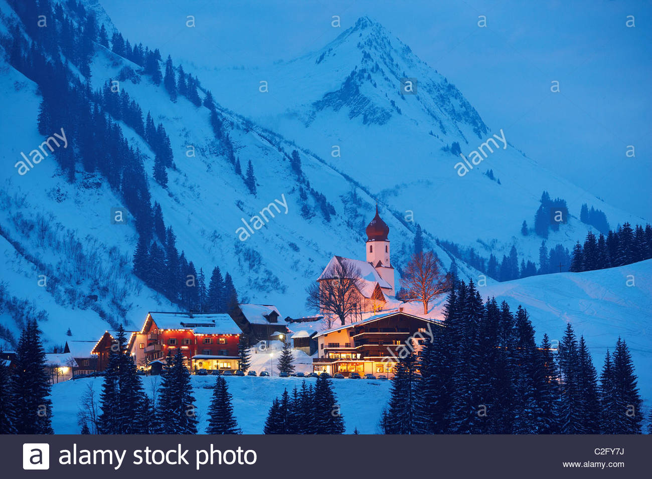 Snow Covered Town In The Evening Damuels Austria Stock