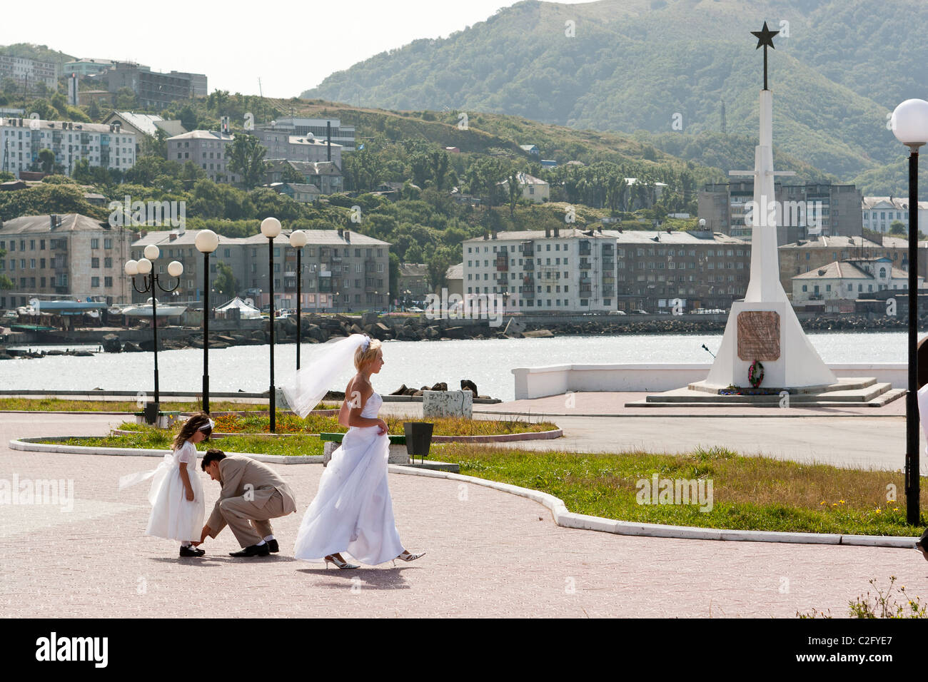 Members Of A Wedding Party And The Bride Walk Along Waterfront In Kholmsk Sakhalin Russia