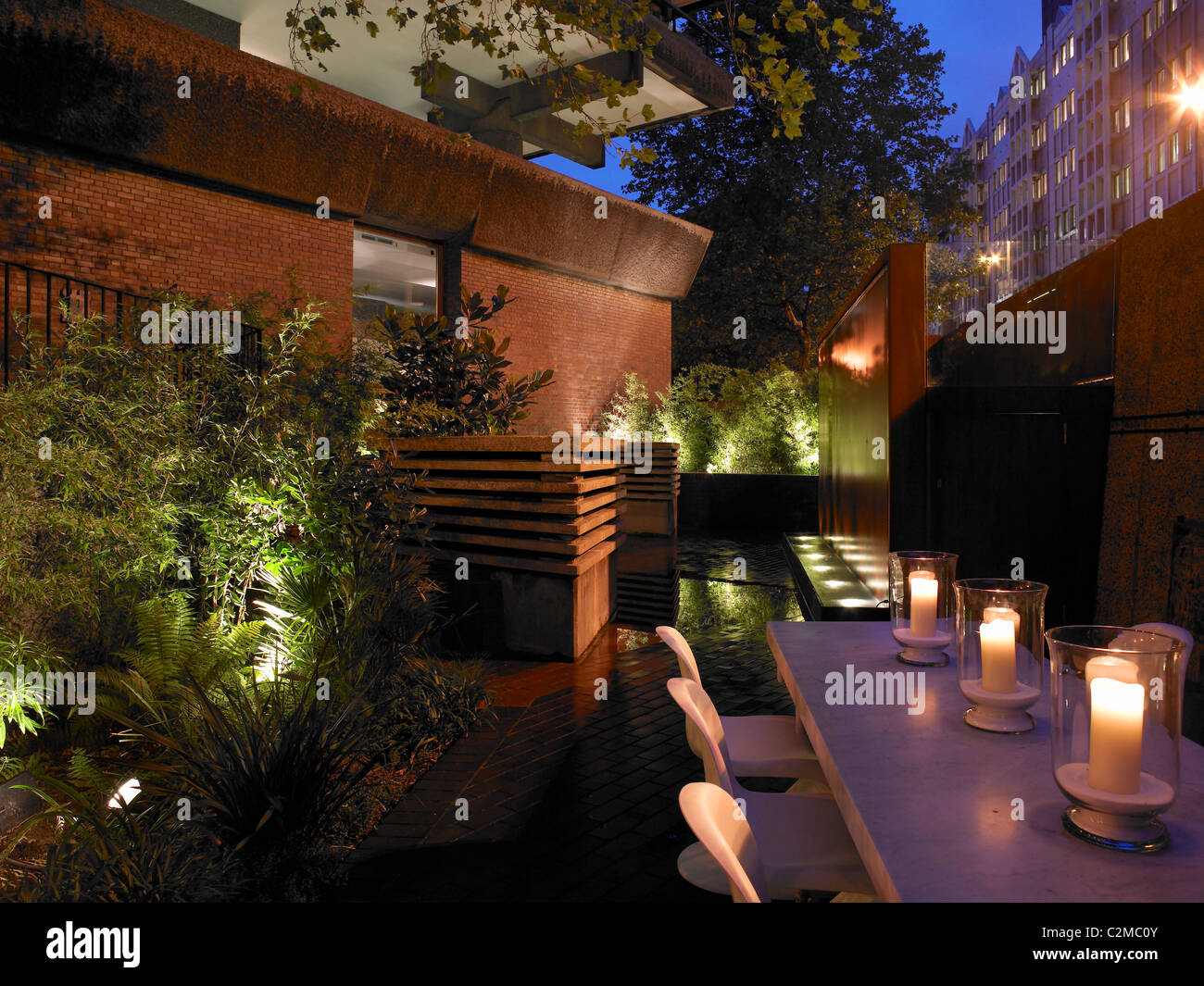 Patio With Table And Candles At Night.