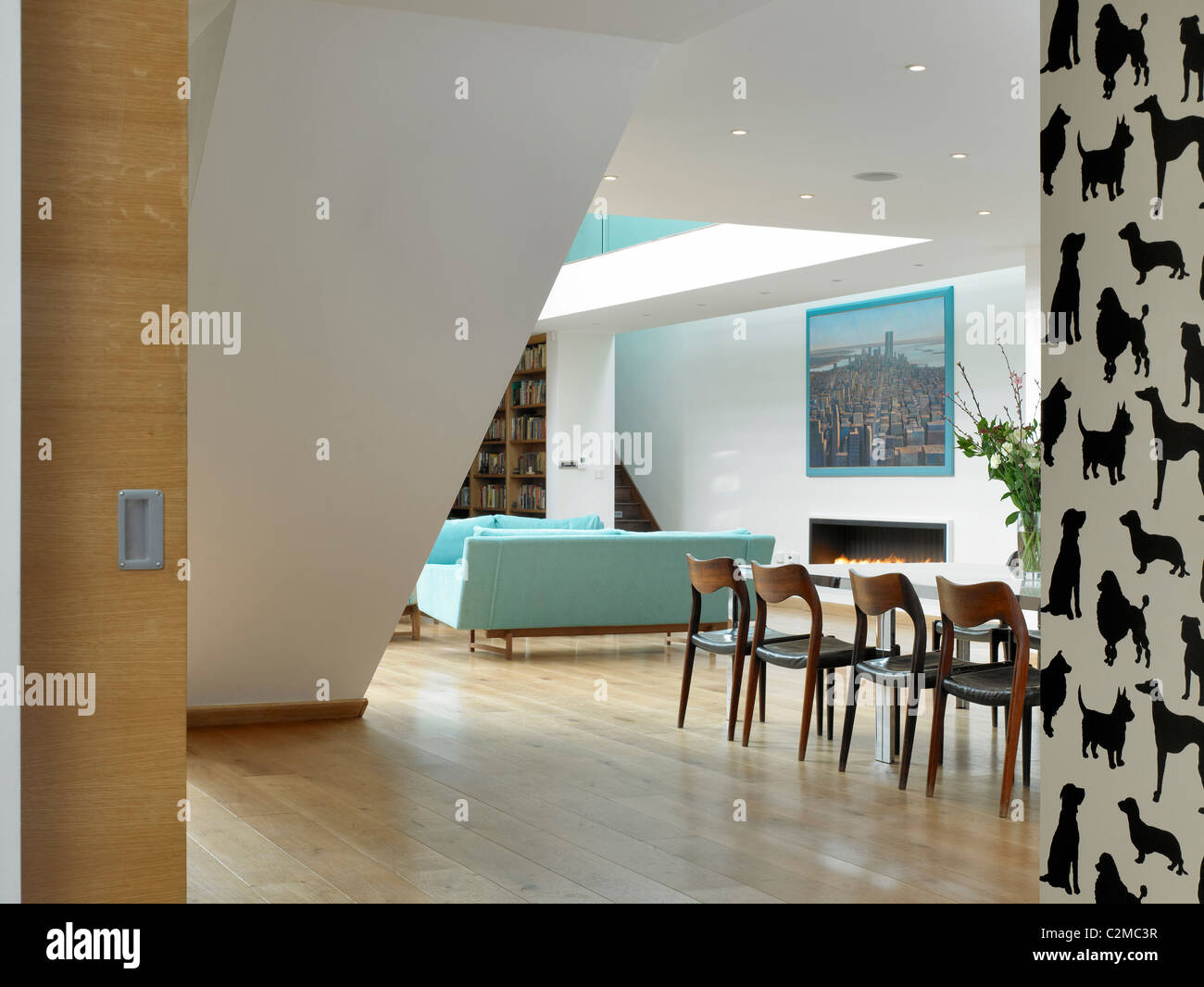 garden house. openplan living room with dog silhouette wallpaper