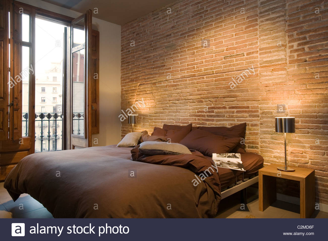 Modern brown bedroom with bare brick wall and full length for Bedroom w brick wall
