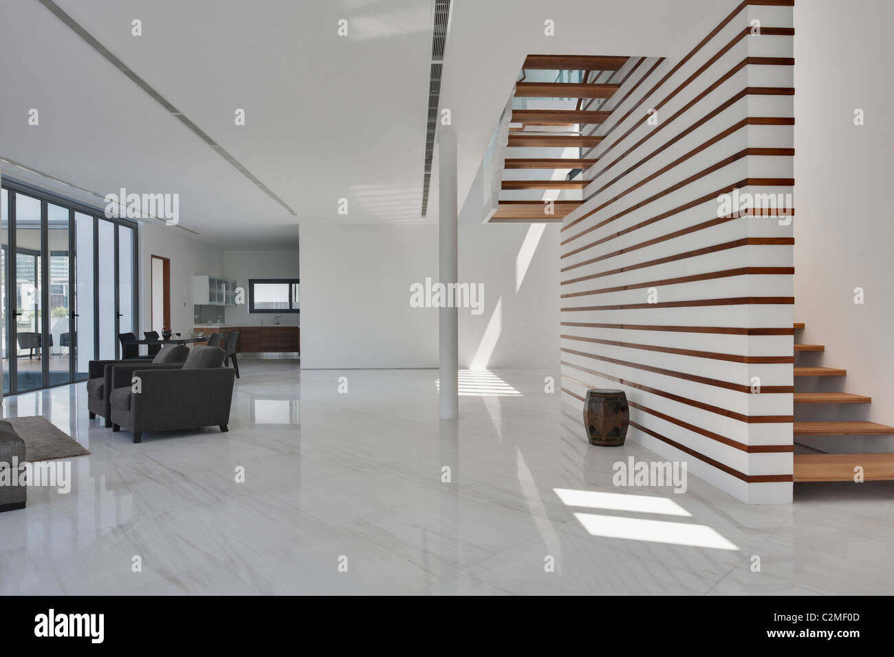 Modern house spacious white open plan living area and for Modern house stairs