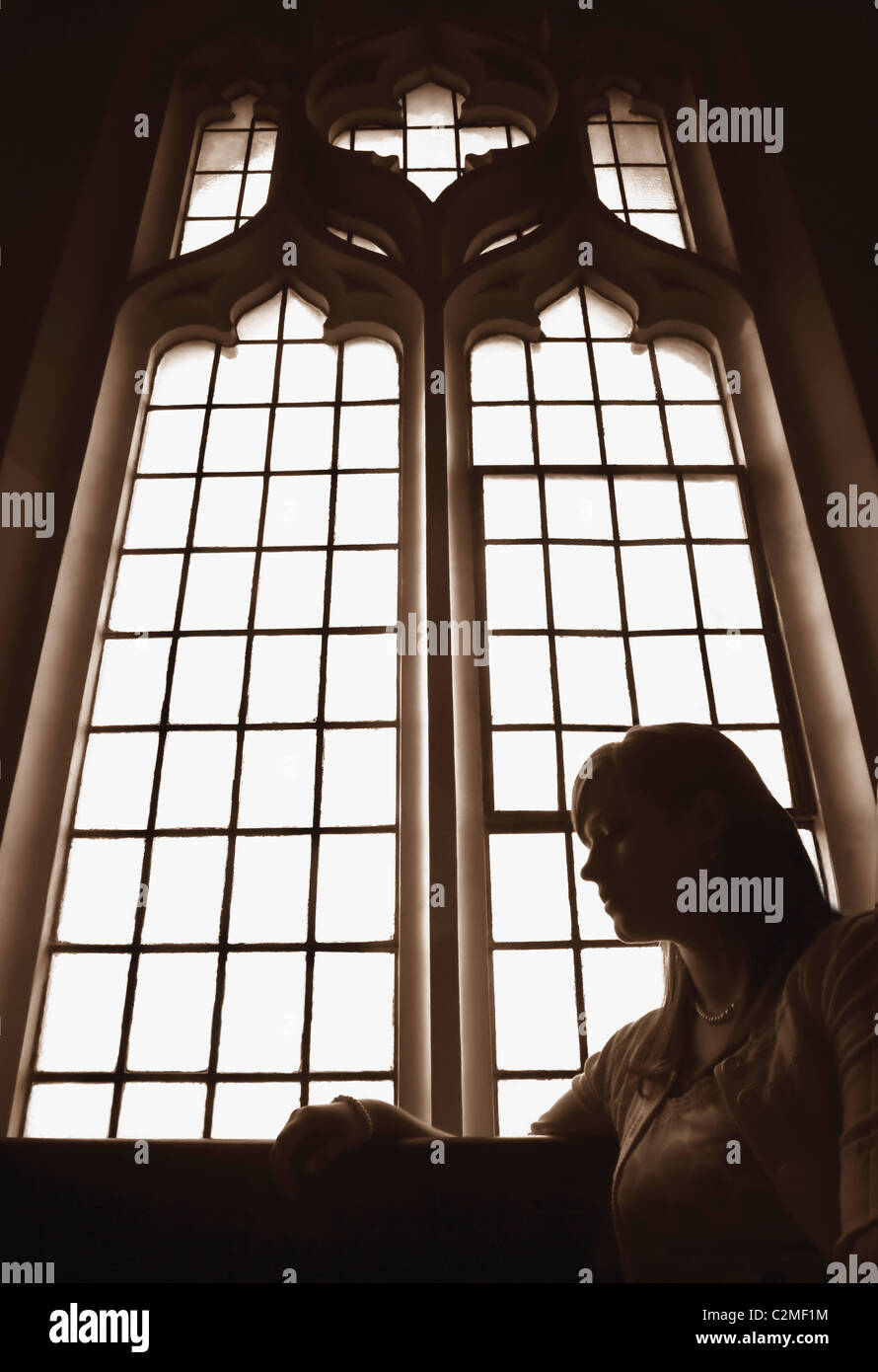 Silhouette of the holy cross on background of storm clouds stock - Silhouette Of Woman In Front Of Church Window Stock Image