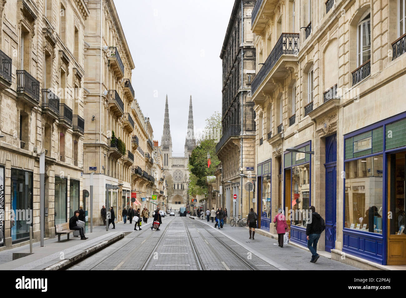 Shops on Rue Vital-Carles with spires of the Cathedral St Andre in ...