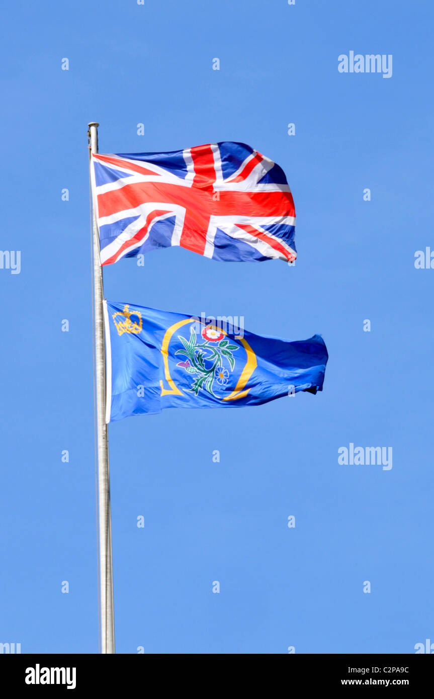 union flag and the emblem flag of the uk supreme court seen above