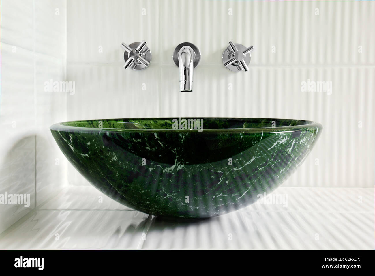 Modern style green marble vessel sink with wall mount faucets on ...