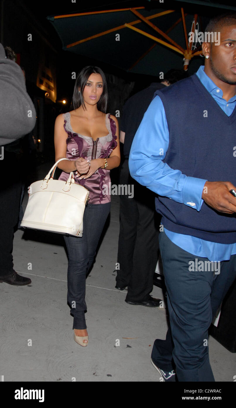 Kim kardashian and reggie bush leaving koi restaurant los for Koi restaurant los angeles