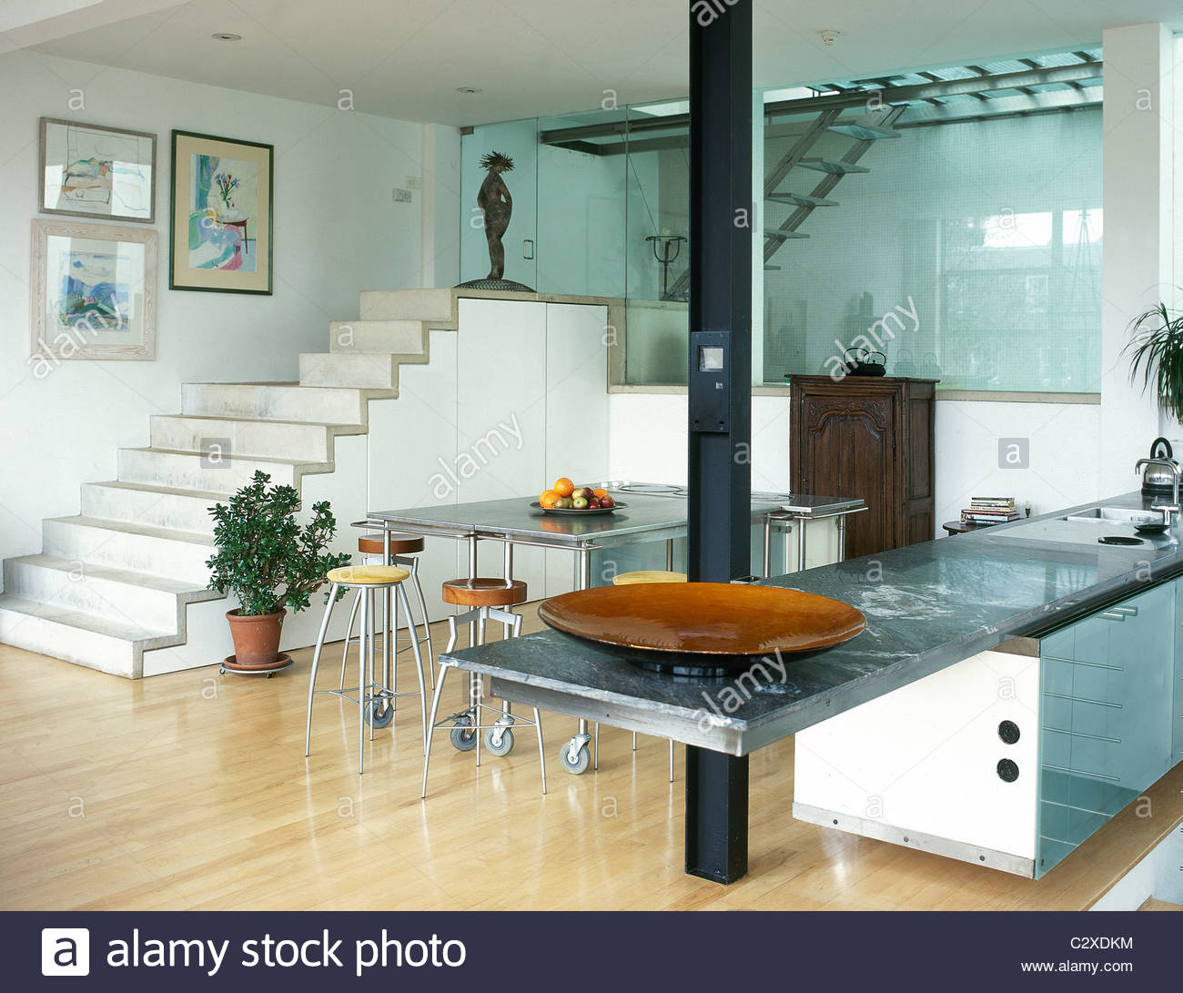 For Kitchen Diners Modern Kitchen Diner Stone Steps Metal Table Tops Stock Photo