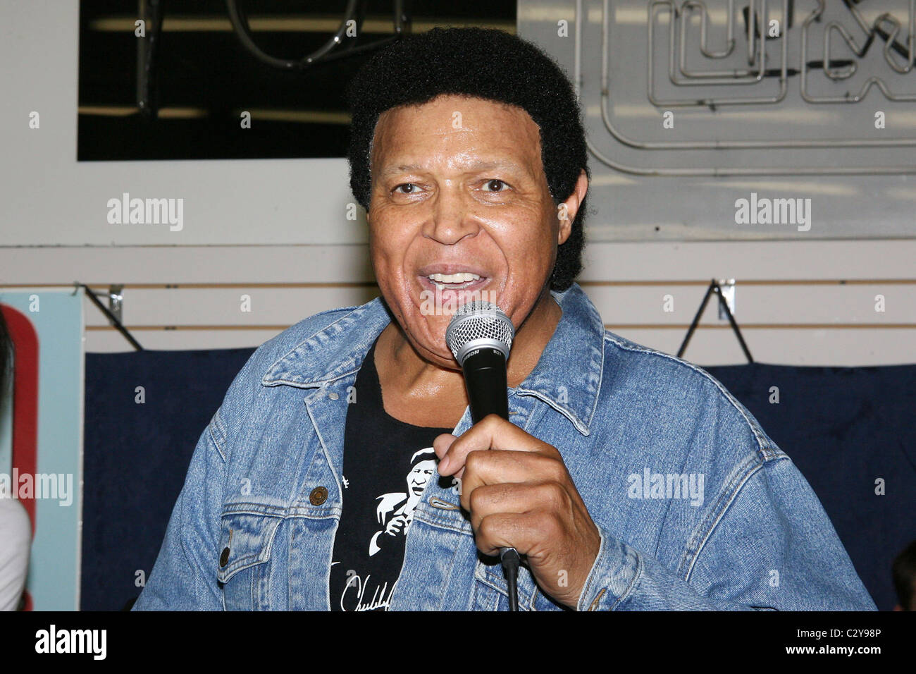Chubby checker with a microphone