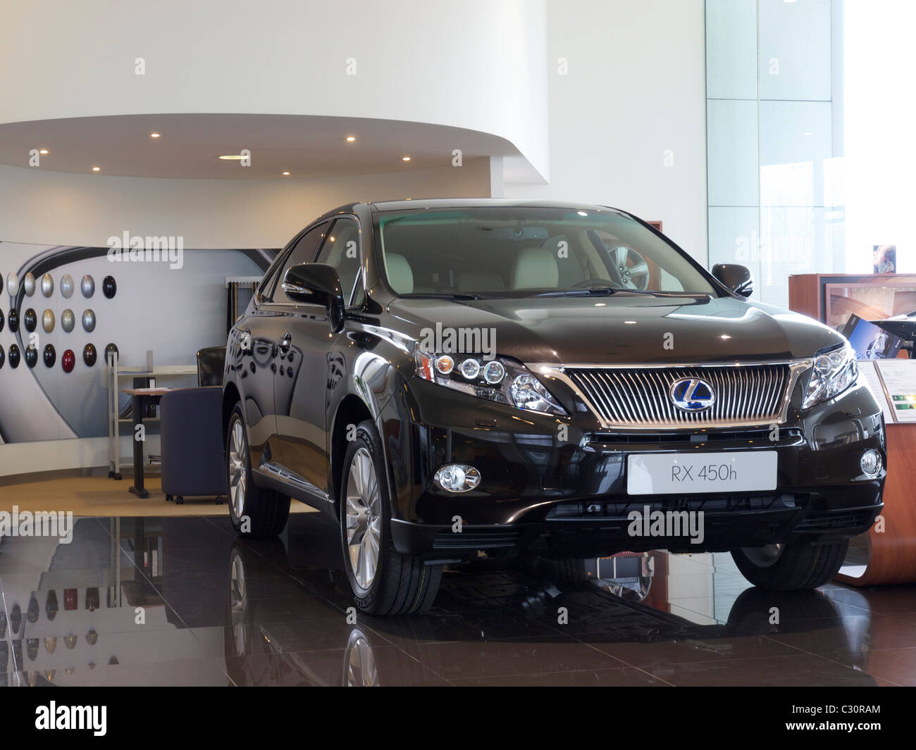 new Lexus RX450h hybrid SUV car in the showroom in Hasselt