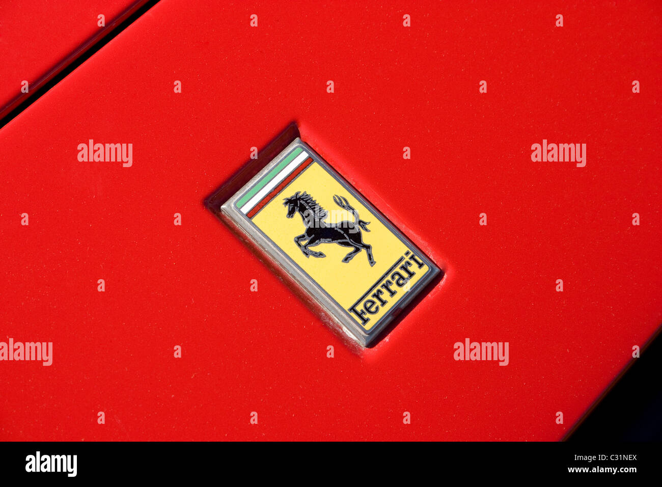 Prancing horse stock photos prancing horse stock images alamy red ferrari badge prancing horse black tricolor green white red italian yellow sports prestige close up biocorpaavc Gallery