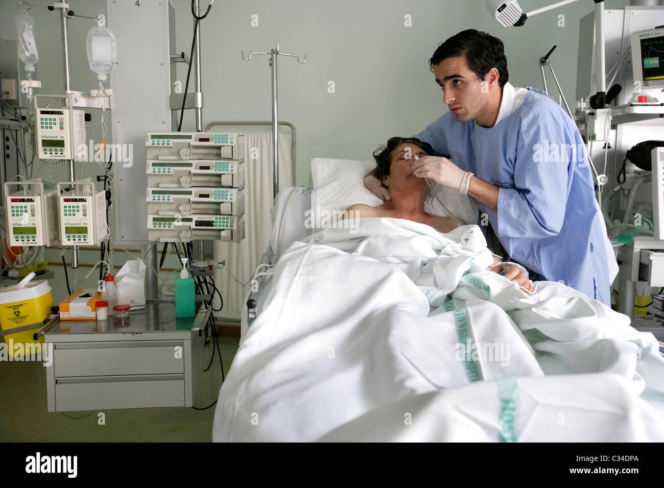 Male nurse taking care of patient in an hospital bed Stock ...