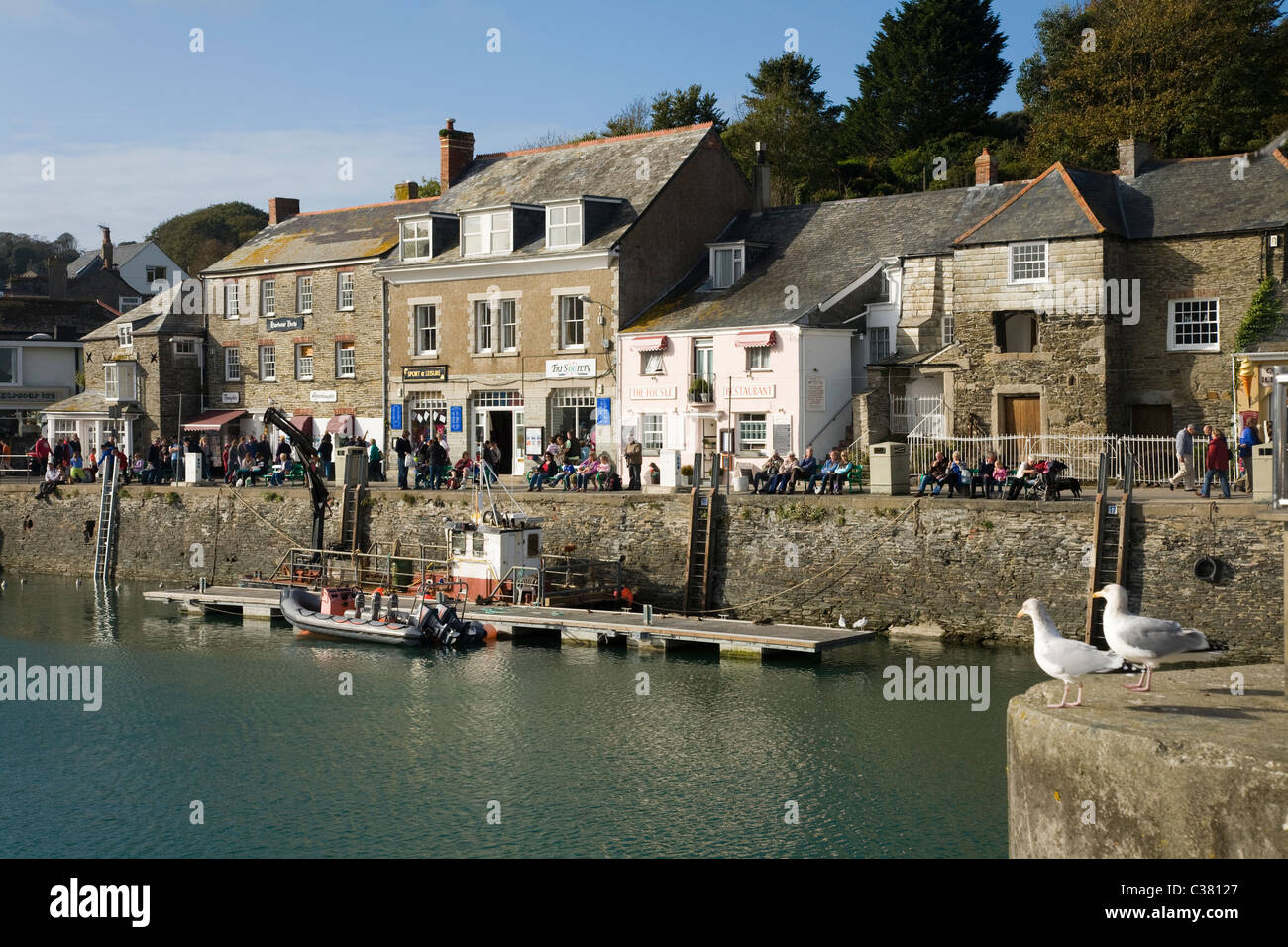 harbour wall quayside buildings building shops shop pub harbour wall quayside buildings building shops shop pub pubs house home homes on quay side padstow cornwall uk