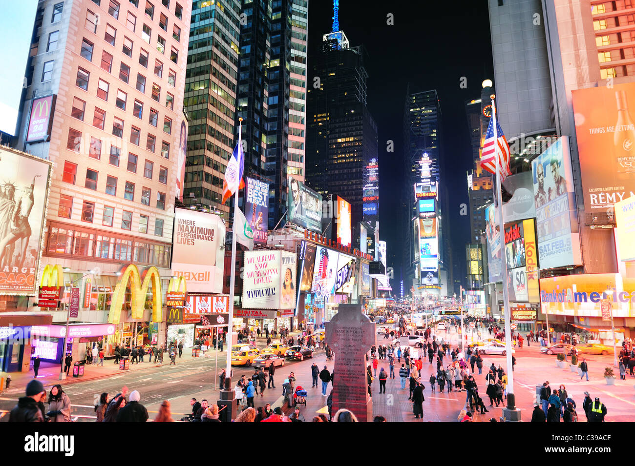 Times Square at night street view with busy traffic in ...