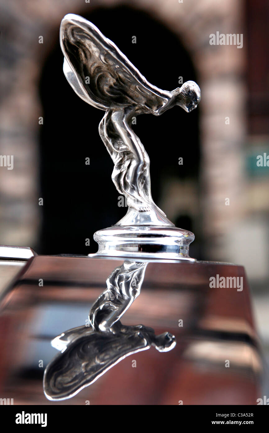 rolls royce car logo. a sideview detail of rollsroyce car and its logo the famous winged woman statue rolls royce o