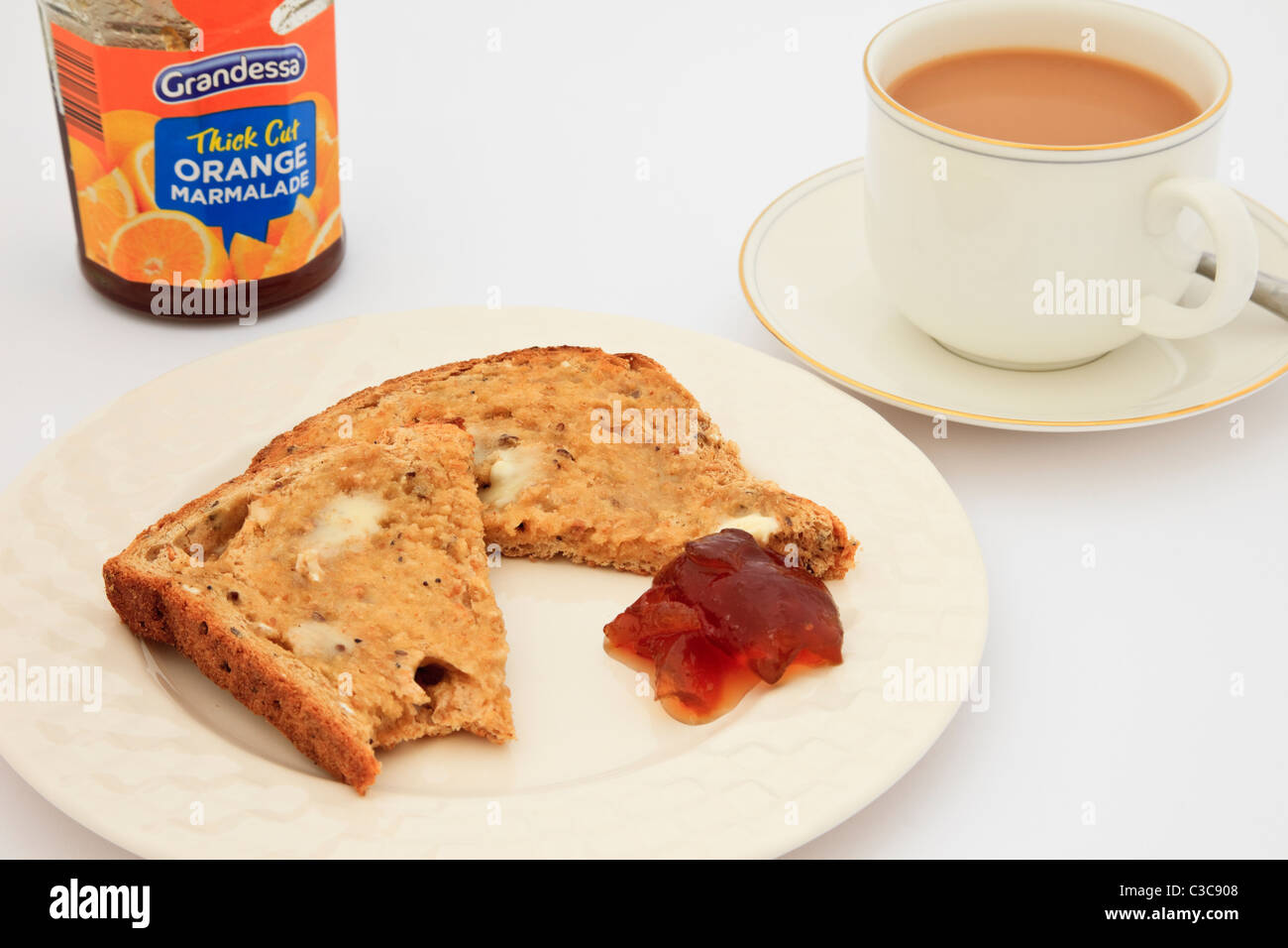Uk A Slice Of Partly Eaten Brown Bread Toast With Margarine And A Jar Of