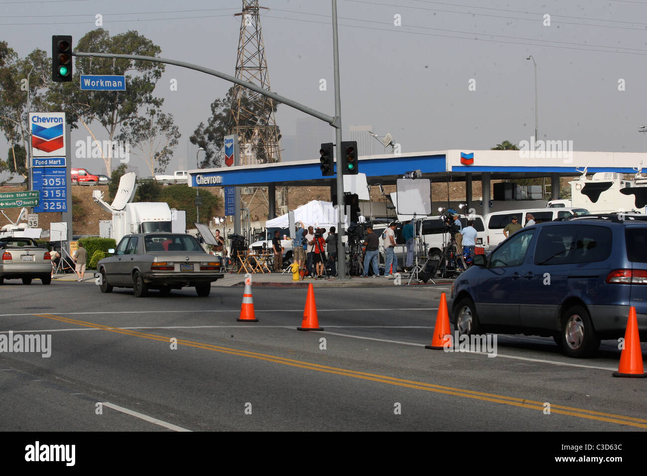 Crowds and media crews gather outside the Los Angeles County Stock ...