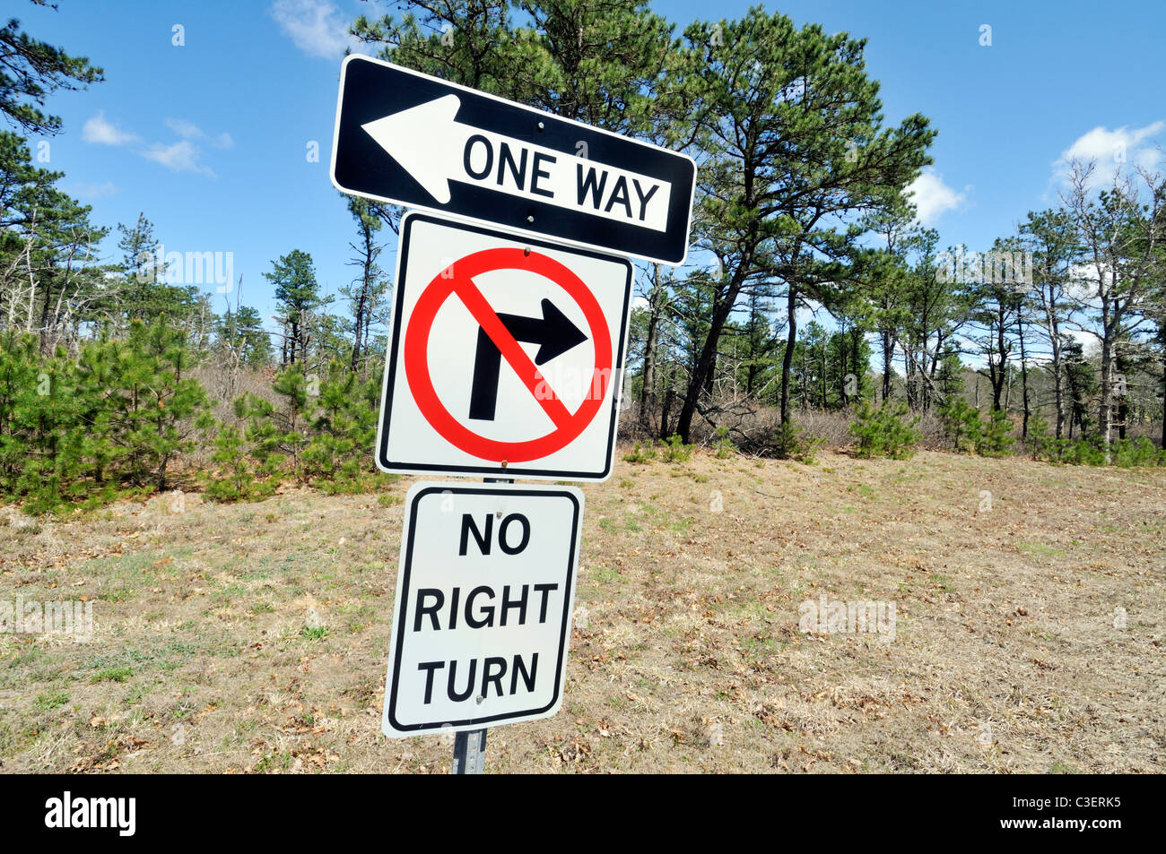 confusing traffic signs posted on side of road on a clear