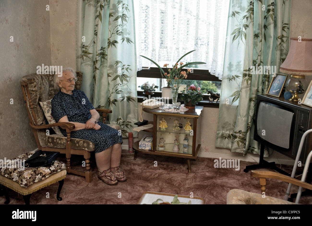 old woman sitting alone in her living room Stock Photo, Royalty ...