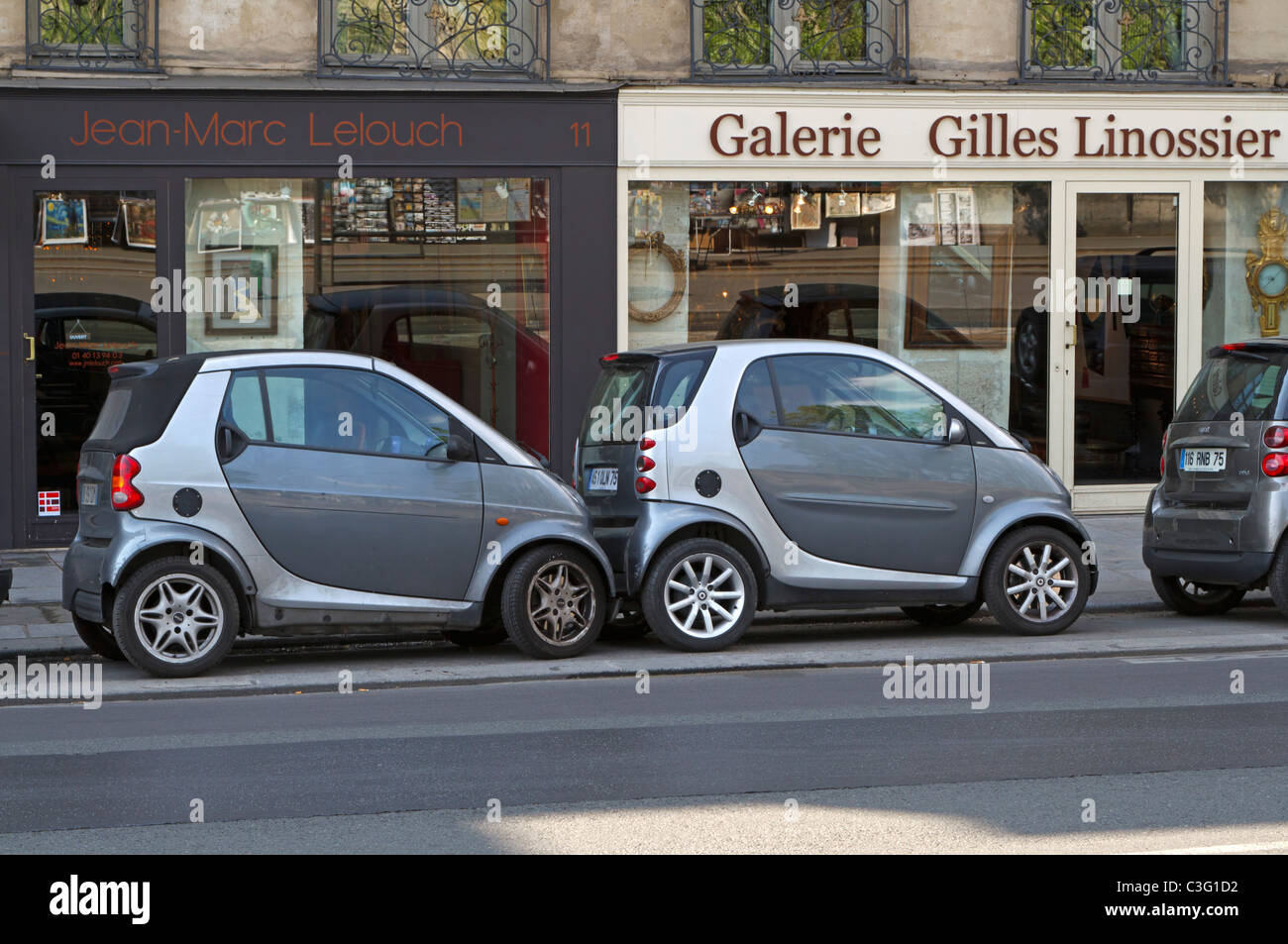 parking in paris smart cars are parked touching each other in tight stock photo royalty free. Black Bedroom Furniture Sets. Home Design Ideas