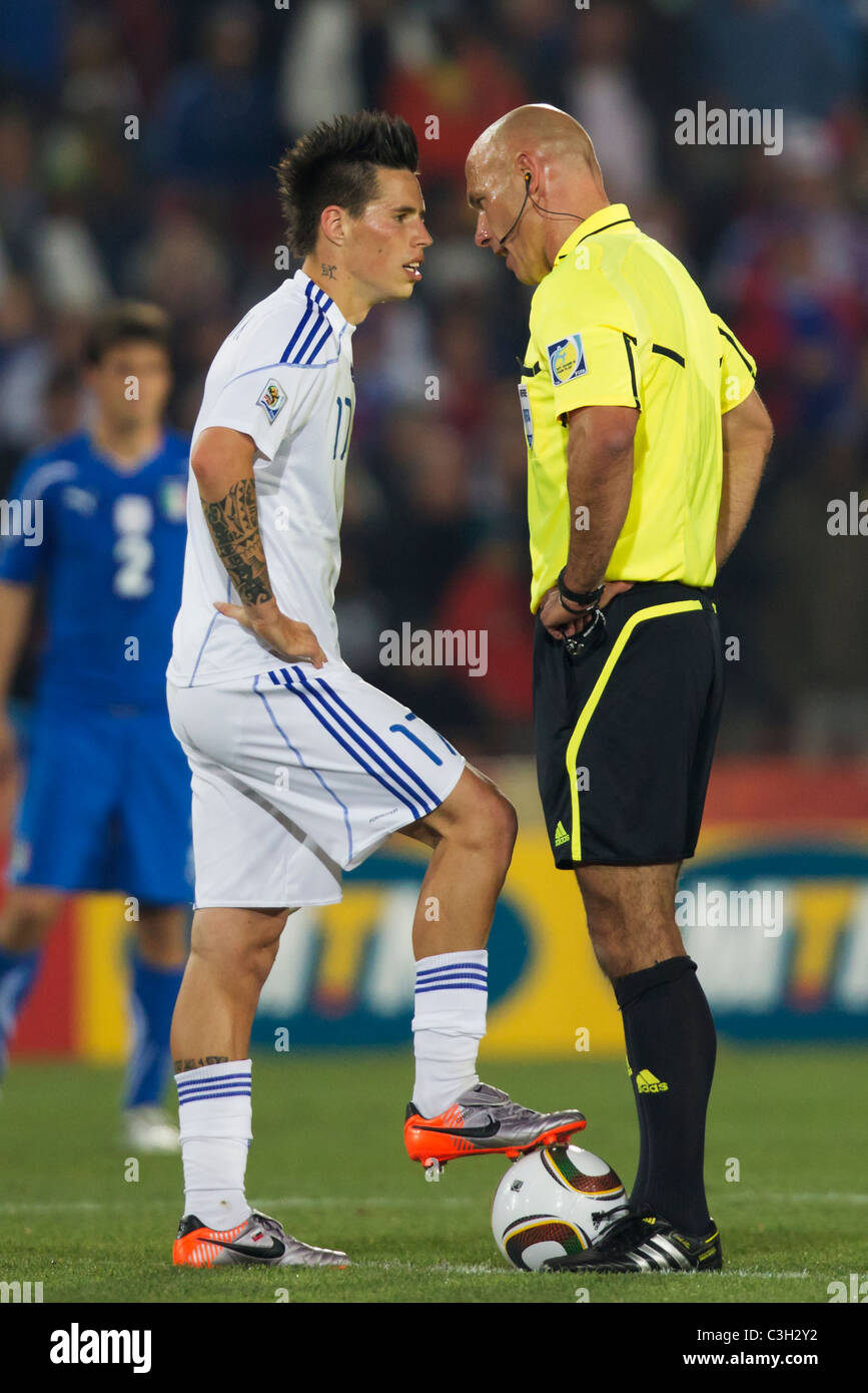 Referee Howard Webb r cautions Marek Hamsik of Slovakia l