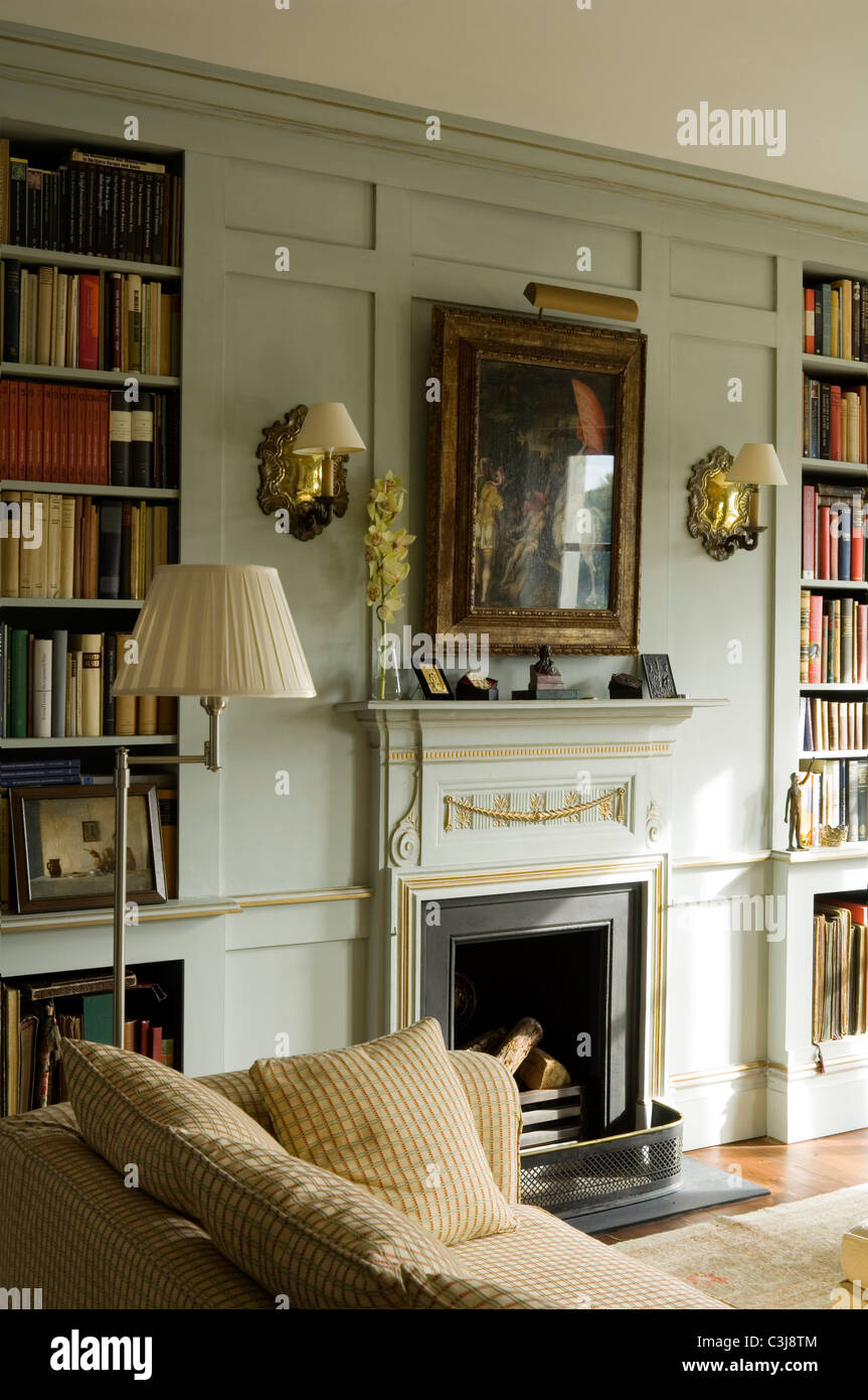 Regency style fireplace flanked by open book shelving in for Open shelves in living room