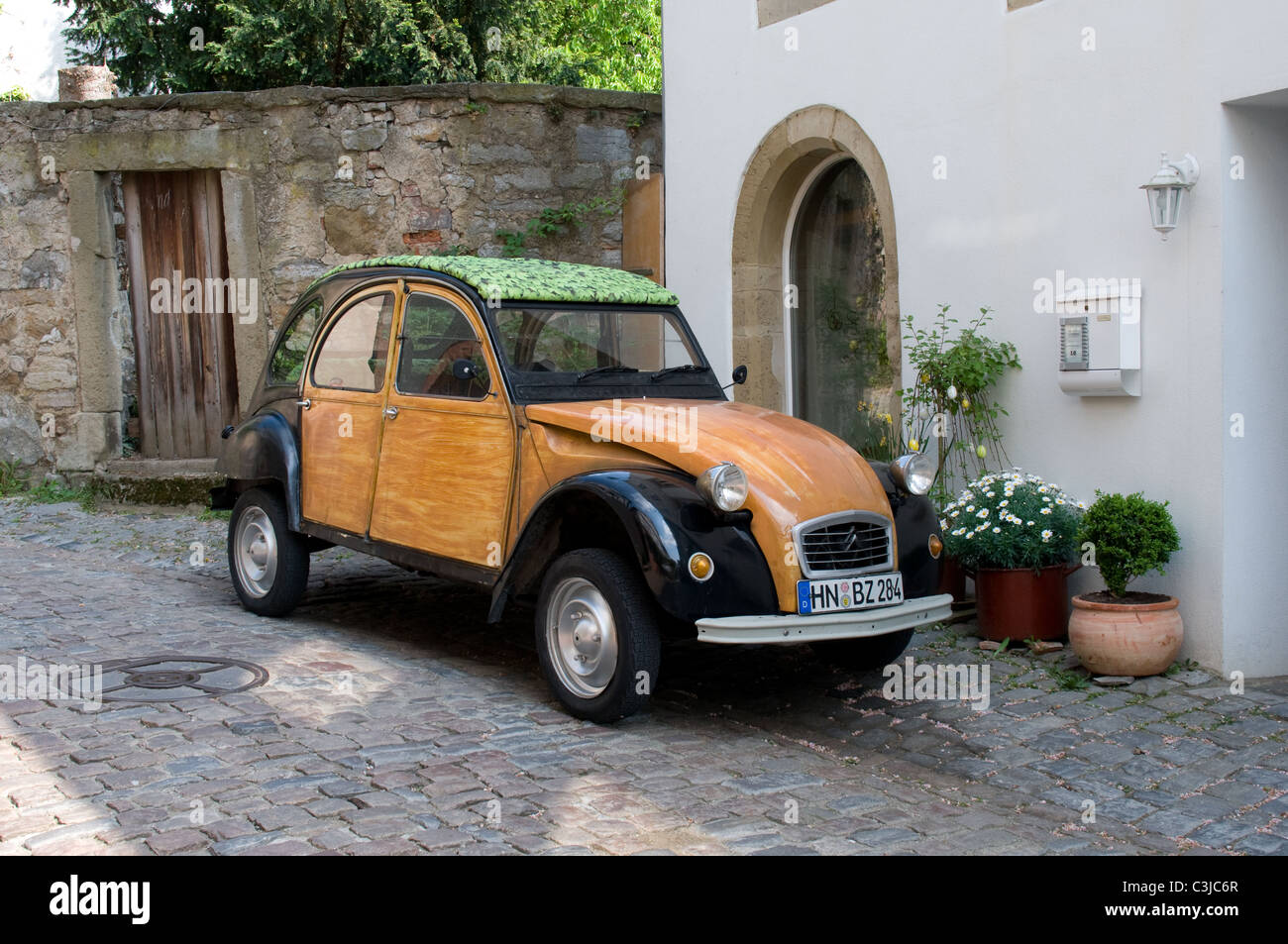 2cv roof citroen 2cv 2cv6 hood roof brand new for sale a citroen 2cv with wood effect panels and green leaf pattern roof park in a street in germany vanachro Choice Image