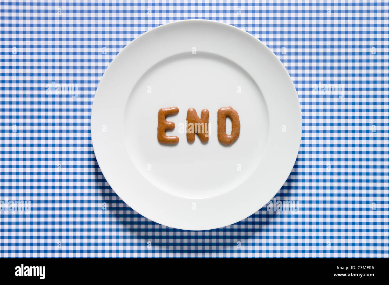 Word end written with russian bread on dish close up Stock
