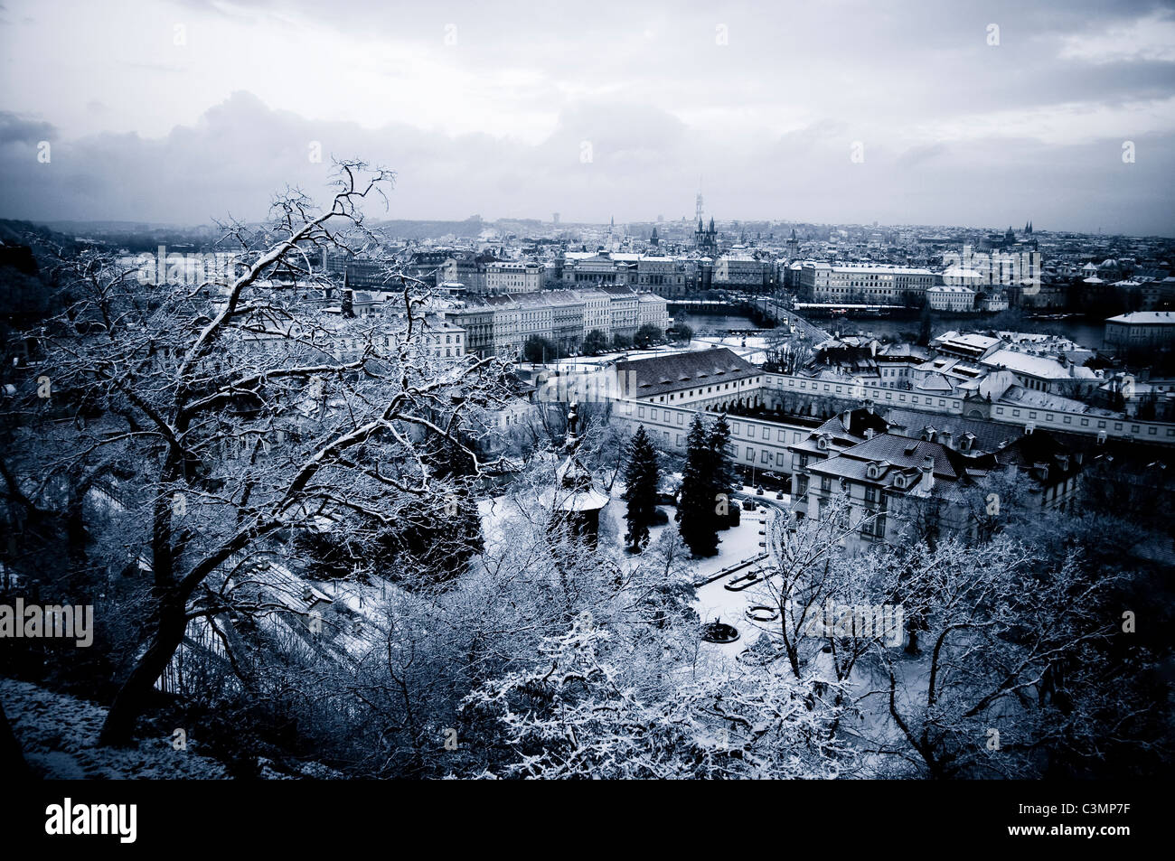 snowy city landscape of prague in winter stock photo