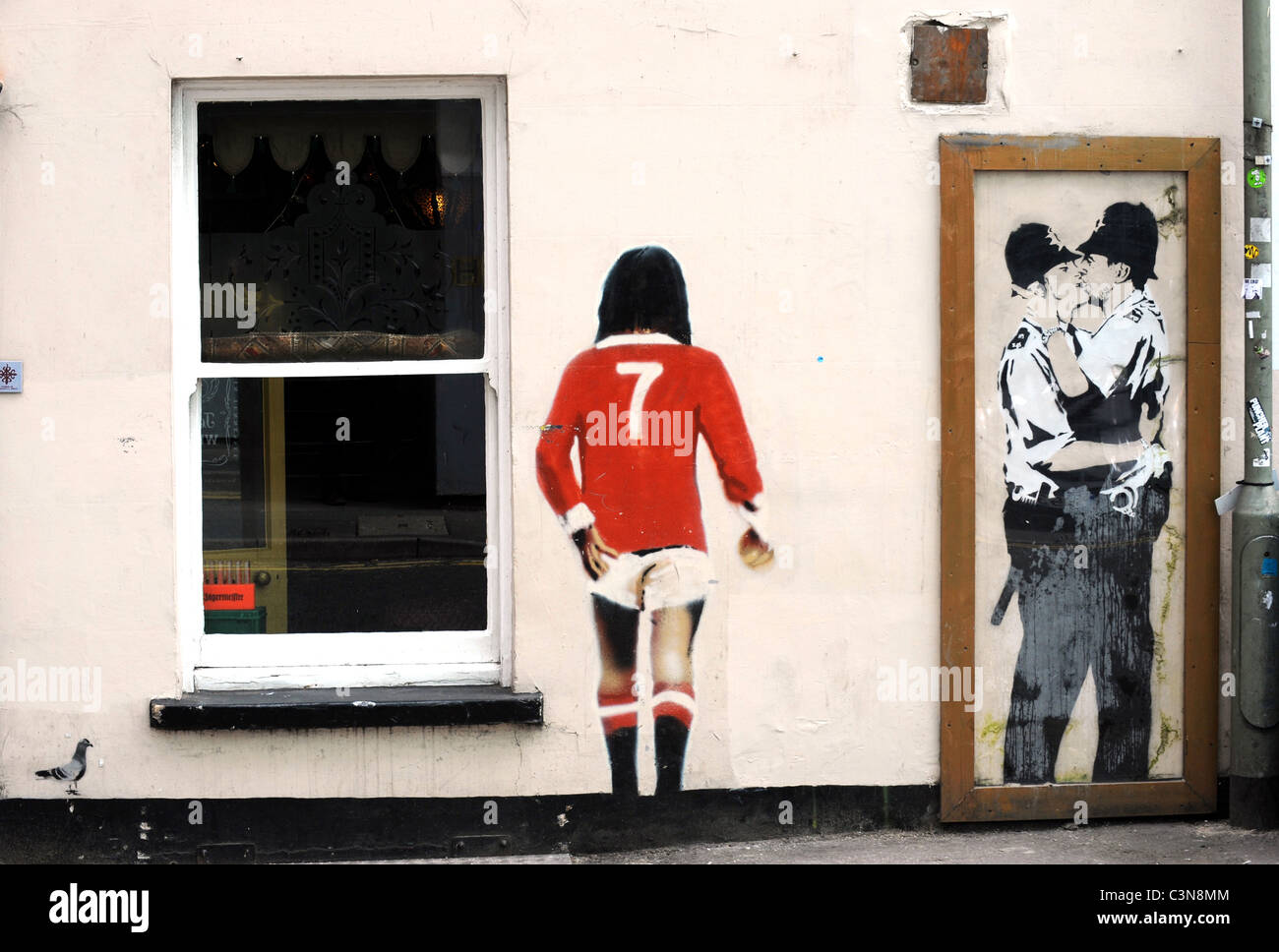 kissing coppers stock photos kissing coppers stock images alamy banksy graffiti on the wall of the prince albert pub in brighton the kissing policemen