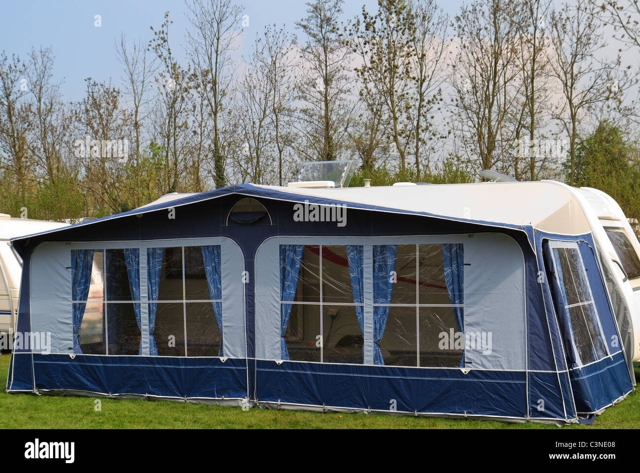 long trailer caravan with awning tent with blue curtains & long trailer caravan with awning tent with blue curtains Stock ...