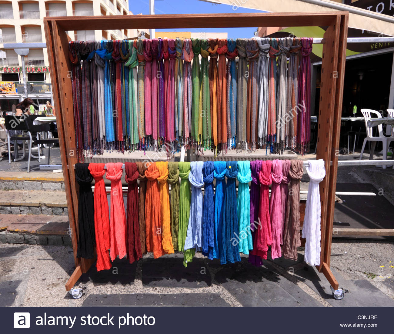 Colourful/colorful display of scarves for sale outside a store ...
