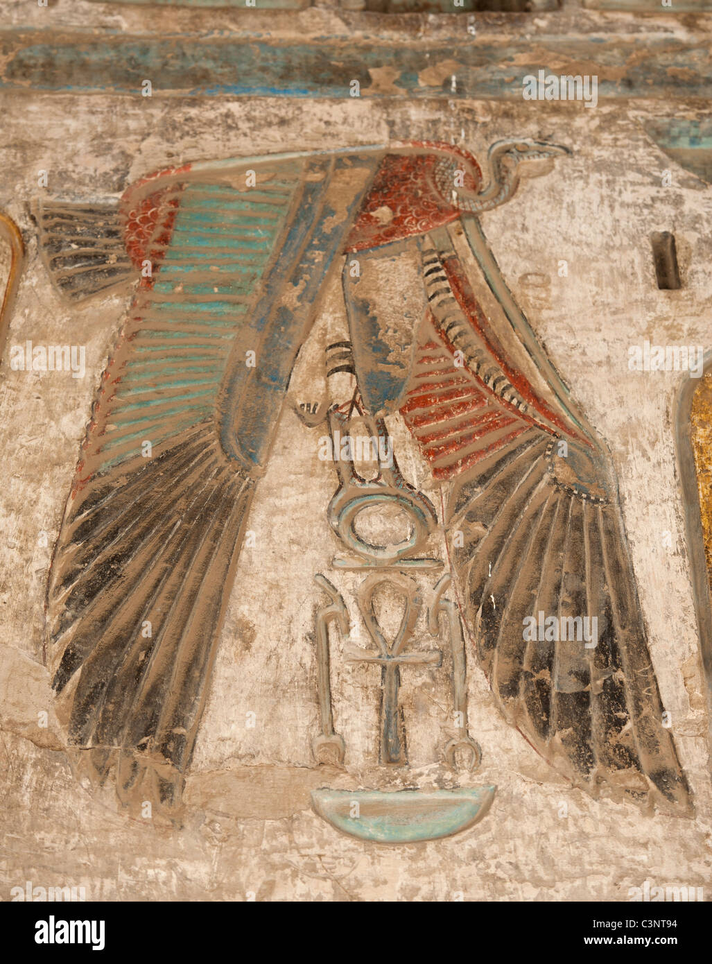 Egyptian hieroglyphic carvings on a wall at the temple of