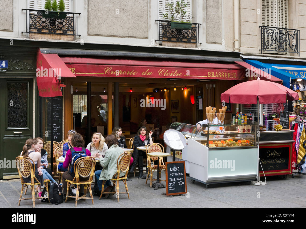 Outdoor cafe in paris with tower in background - Sidewalk Cafe Near The Cathedral Of Notre Dame De Paris Ile De La Cite