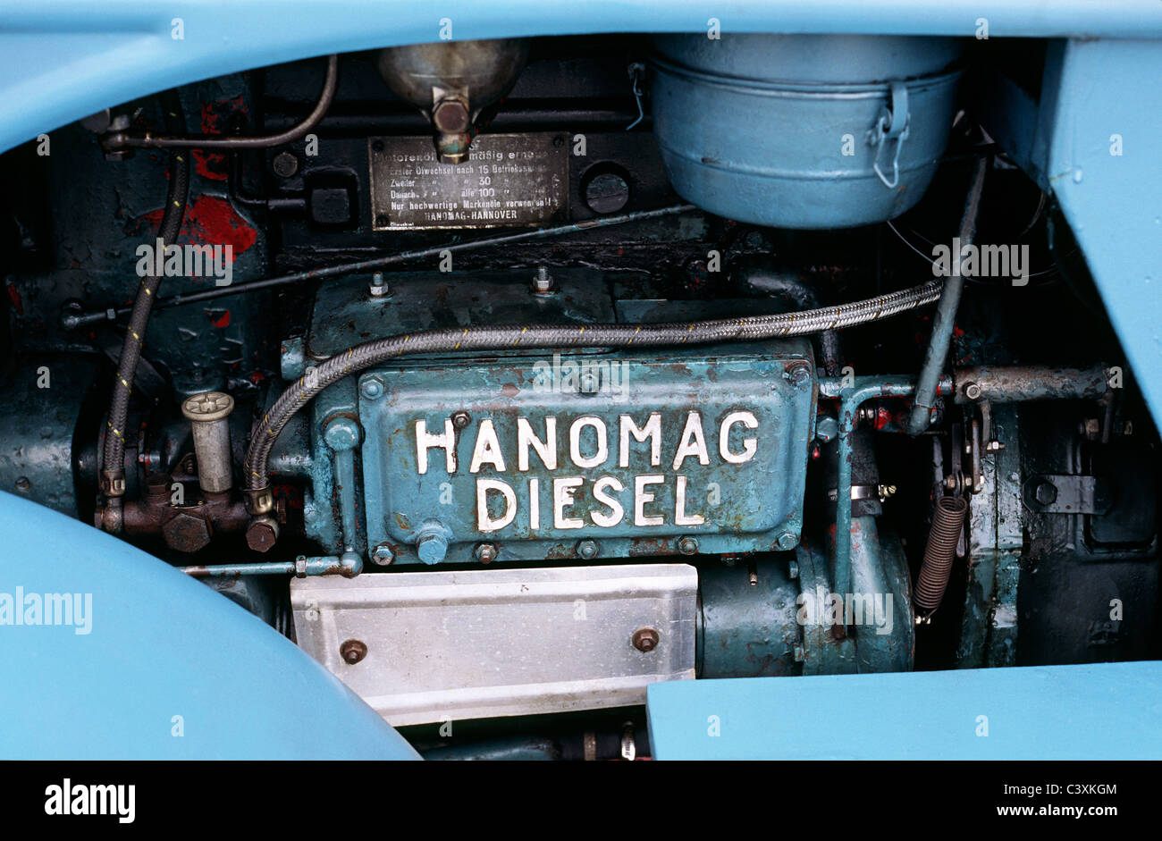 engine of a vintage r45 hanomag diesel tractor in bremerhaven in stock photo royalty free image. Black Bedroom Furniture Sets. Home Design Ideas