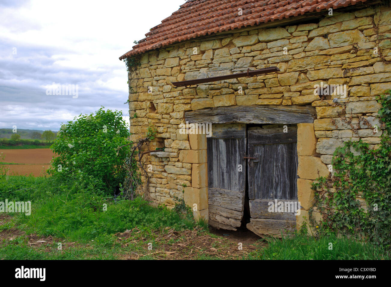 And Old Stone Barn With Weathered Wooden Door And Wooden
